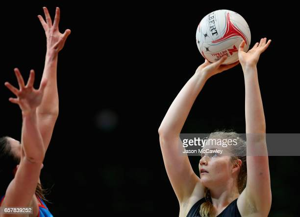 Sam Gooden of the Magpies shoots for goal during the round six ANL match between the Netball NSW Waratahs and the Tasmanian Magpies at Sydney Olympic...