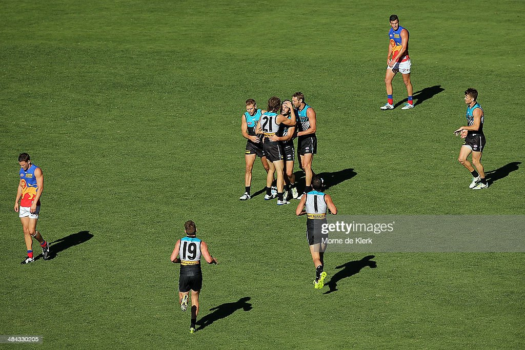 Sam Gray of the Power is congratulated by teammates after kicking a goal during the round 4 AFL game between Port Adelaide and the Brisbane Lions at Adelaide Oval on April 12, 2014 in Adelaide, Australia.