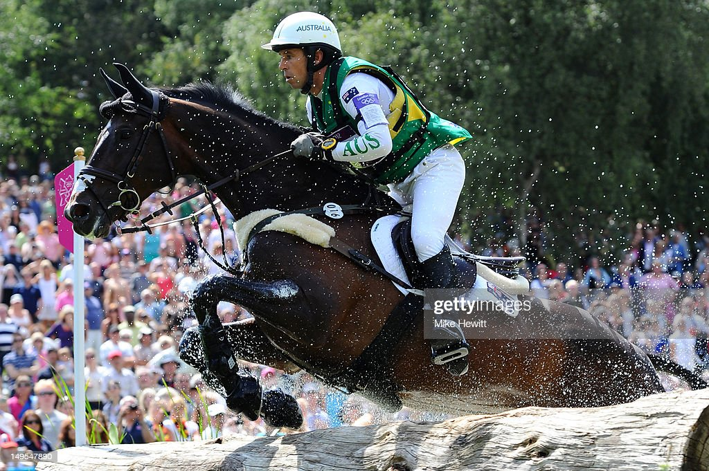 Sam Griffith of Australia riding Happy Times in the water in the Eventing Cross Country Equestrian event on Day 3 of the London 2012 Olympic Games at...