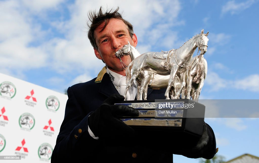 Sam Griffiths of Australia celebrates with the trophy after winning on Paulank Brockagh on day five of the Badminton Horse Trials on May 11, 2014 in Badminton, England.