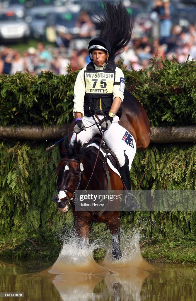 Sam Griffiths of Australia riding Happy Times as they compete in the cross country stage during day three of the Badminton Horse Trials on April 24, 2011 in Badminton, Gloucestershire.