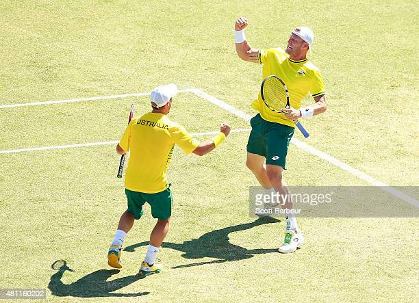 Sam Groth and Lleyton Hewitt of Australia celebrate match point as they defeat Andrey Golubev and Aleksandr Nedovyesov of Kazakhstan in the doubles...