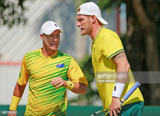 Sam Groth and Lleyton Hewitt of Australia look on as they play Andrey Golubev and Aleksandr Nedovyesov of Kazakhstan in the doubles during day two of...