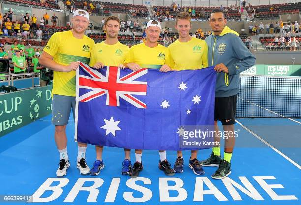 Sam Groth Jordan Thompson Lleyton Hewitt John Peers and Nick Kyrgios of Australia pose for a photo after their victory in the Davis Cup World Group...