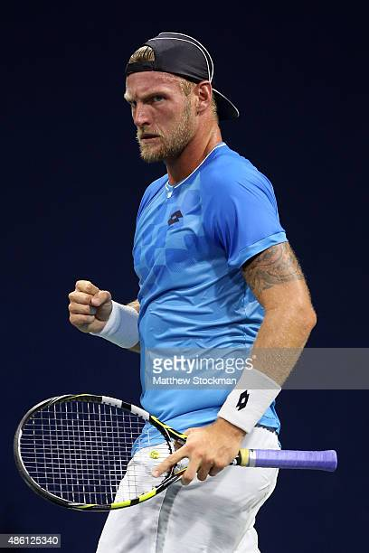 Sam Groth of Australia celebrates a point against Alexandr Dolgopolov of Ukraine during their Men's Singles First Round match on Day One of the 2015...