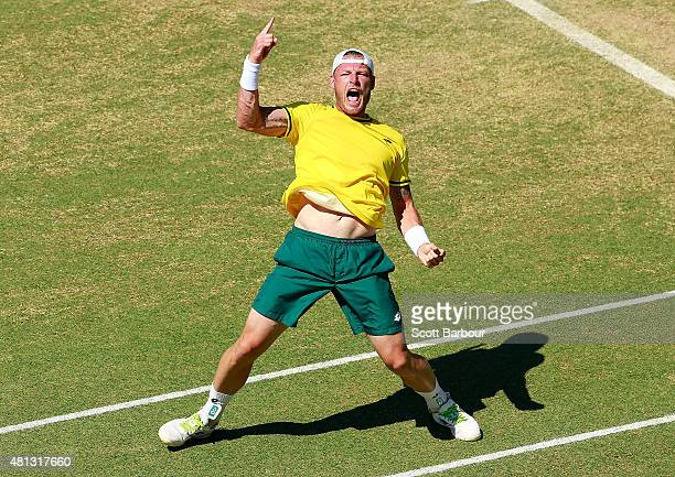 Sam Groth of Australia celebrates match point after winning the reverse singles match between Sam Groth of Australia and Mikhail Kukushkin of...