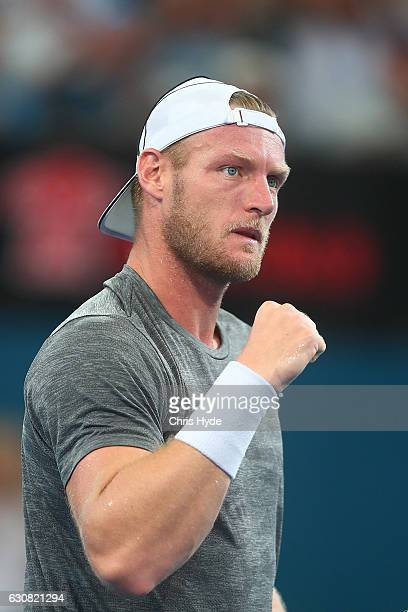 Sam Groth of Australia celebrates winning his match against PierreHughes Herbert of France on day three of the 2017 Brisbane International at Pat...