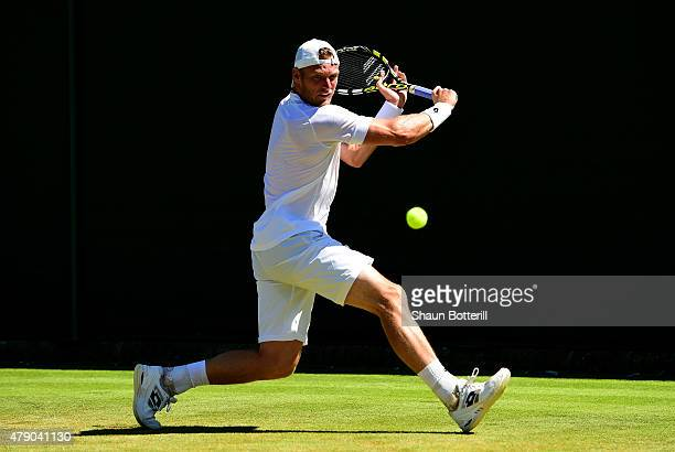 Sam Groth of Australia in action in his Gentlemens Singles first round match against Jack Sock of the United States during day two of the Wimbledon...