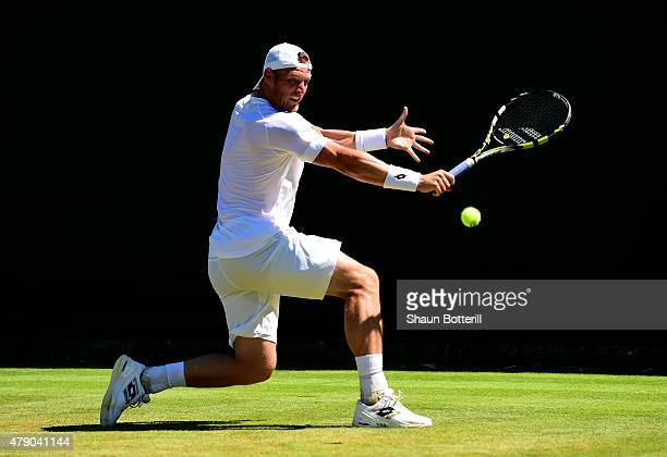 Sam Groth of Australia in action in his Gentlemen's Singles first round match against Jack Sock of the United States during day two of the Wimbledon...
