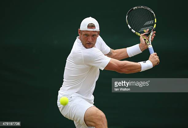 Sam Groth of Australia plays a backhand in his Gentlemen's Singles second round match against James Duckworth of Australia during day four of the...