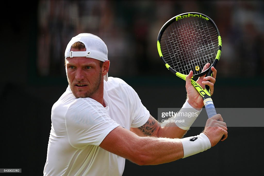 Sam Groth of Australia plays a backhand shot during the Men's Singles first round against Kei Nishikori of Japan on day one of the Wimbledon Lawn Tennis Championships at the All England Lawn Tennis and Croquet Club on June 27th, 2016 in London, England.