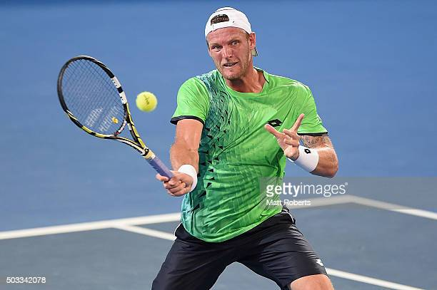 Sam Groth of Australia plays a forehand against Hyeon Chung of South Korea during day two of the 2016 Brisbane International at Pat Rafter Arena on...
