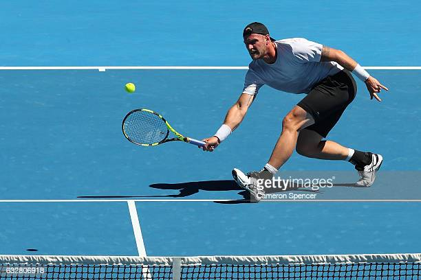 Sam Groth of Australia plays a shot against Sania Mirza of India and Ivan Dodig of Croatia in his mixed doubles semifinal match on day 12 of the 2017...