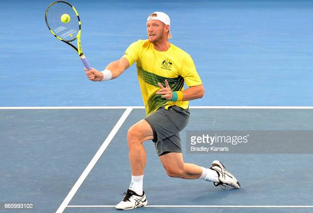 Sam Groth of Australia plays a shot in his doubles match with John Peers against Jack Sock and Steve Johnson of the USA during the Davis Cup World...