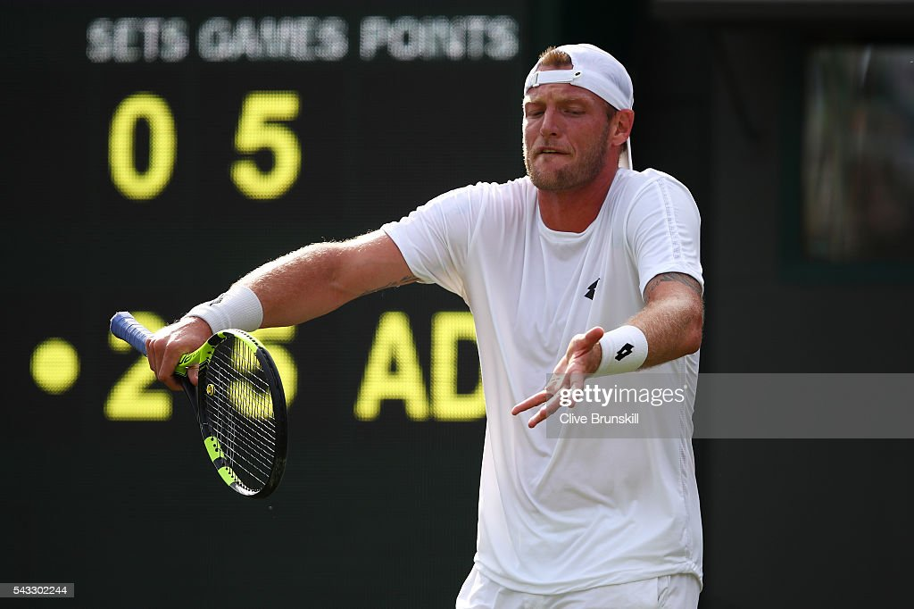 Sam Groth of Australia reacts during the Men's Singles first round against Kei Nishikori of Japan on day one of the Wimbledon Lawn Tennis Championships at the All England Lawn Tennis and Croquet Club on June 27th, 2016 in London, England.