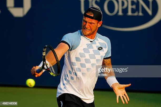 Sam Groth of Australia returns a shot against Tommy Robredo of Spain during their Men's Singles Second Round match against on Day Three of the 2015...