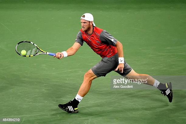 Sam Groth of Australia returns a shot to Roger Federer of Switzerland during their men's singles second round match on Day Five of the 2014 US Open...