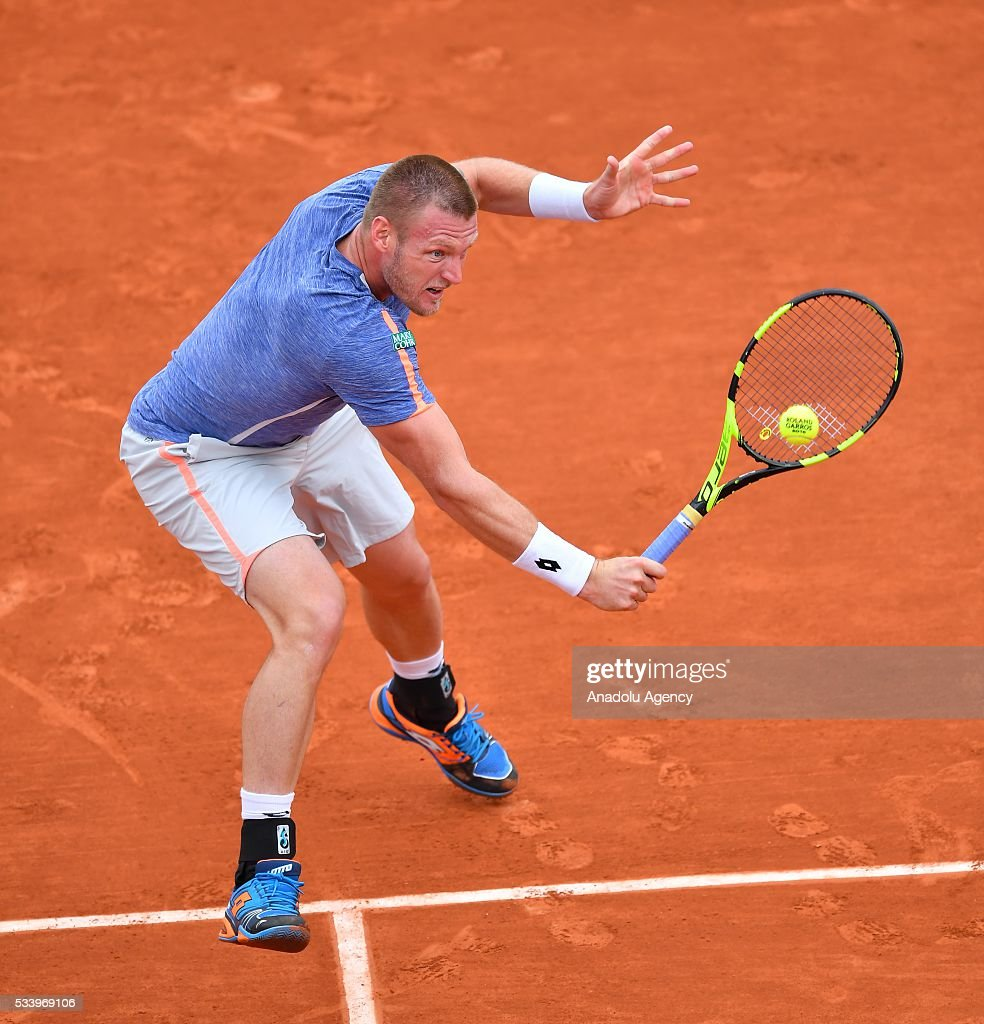 Sam Groth (C) of Australia returns the ball during the men's single first round match against Rafael Nadal of Spain at the French Open tennis tournament at Roland Garros in Paris, France on May 24, 2016.