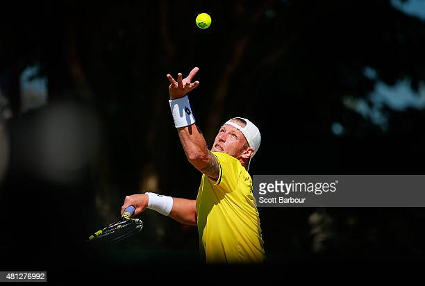 Sam Groth of Australia serves during the reverse singles match between Sam Groth of Australia and Mikhail Kukushkin of Kazakhstan during day three of...