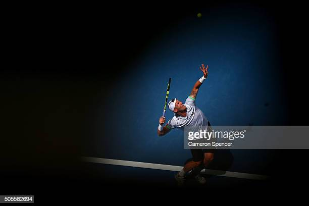 Sam Groth of Australia serves in his first round match against Adrian Mannarino of France during day two of the 2016 Australian Open at Melbourne...