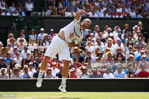 Sam Groth of Australia serves in his Mens Singles Third Round match against Roger Federer of Switzerland during day six of the Wimbledon Lawn Tennis...
