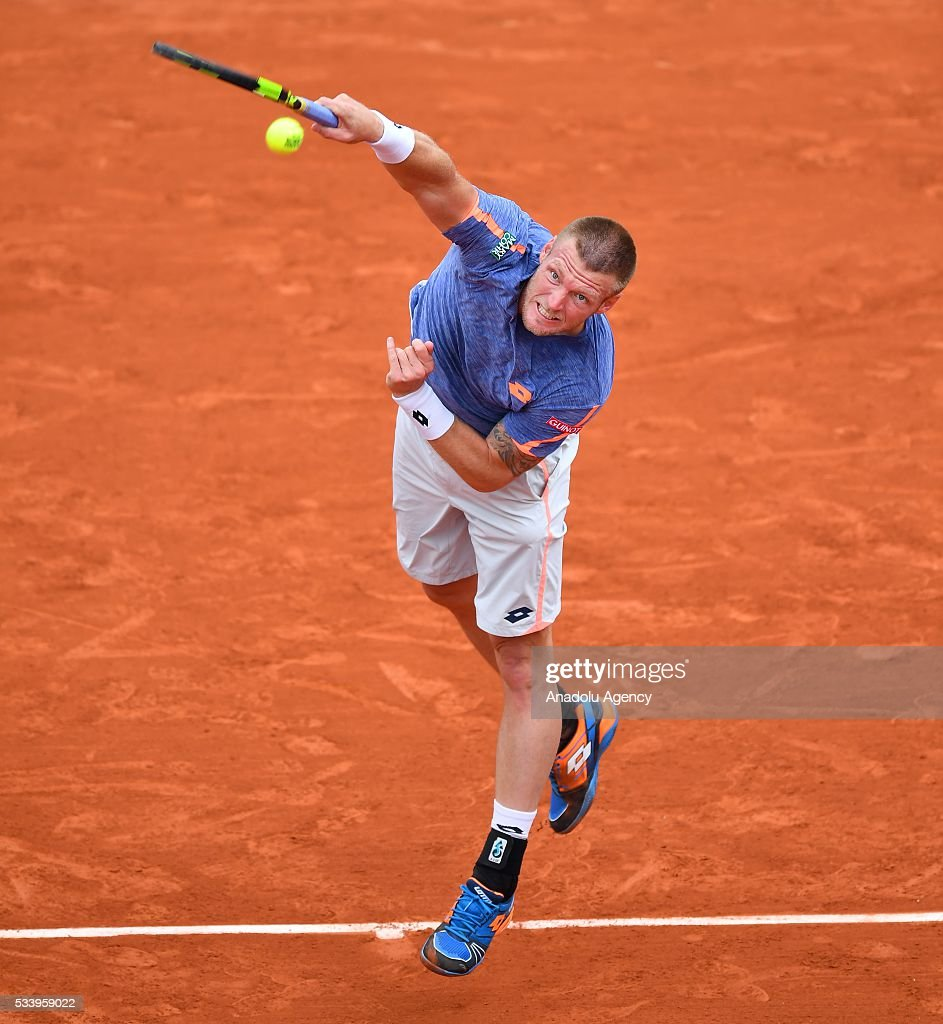 Sam Groth (C) of Australia serves the ball during the men's single first round match against Rafael Nadal of Spain at the French Open tennis tournament at Roland Garros in Paris, France on May 24, 2016.
