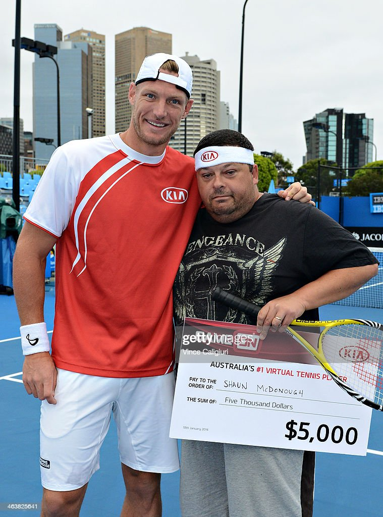 Sam Groth of Australia, who holds the record for the world's fastest serve poses with Shaun McDonough, the winner of the Kia 'Game On' app during day 7 of the 2014 Australian Open at Melbourne Park on January 19, 2014 in Melbourne, Australia.
