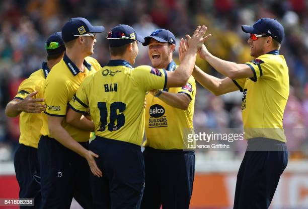 Sam Hain of Birmingham celebrates with team mates after dismissing Aneurin Donald of Glamorgan during the NatWest T20 Blast SemiFinal match between...