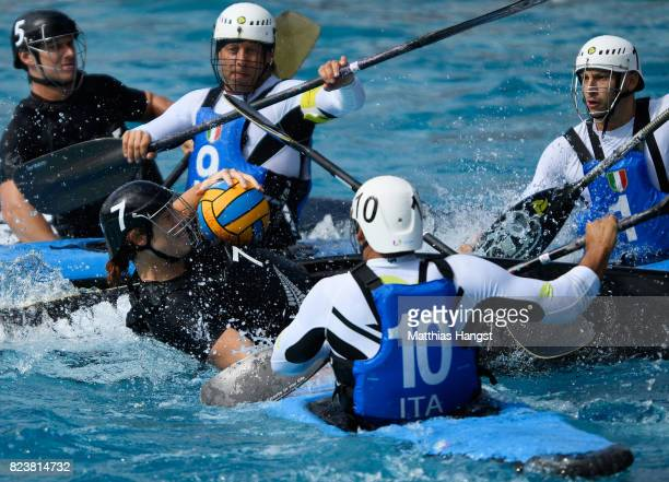 Sam Hapeta of New Zealand breaks through the defence of Italy during the Canoe Polo Men's match between Italy and New Zealand of The World Games at...