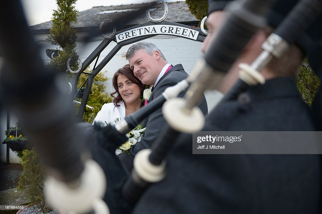 Sam Harris and Adrian Evans pose outside the Gretna Green Famous Blacksmiths Shop on the day of their wedding on Valentine's day on February 14, 2013 in Gretna,Scotland. Gretna Green is one of the most popular wedding destinations in Scotland hosting thousands of weddings each year with a particular rise on St Valentine's Day. Gretna Green has been hosting marriages in the blacksmiths shop since 1754.