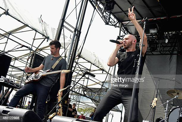 Sam Harris of X Ambassadors performs during Billboard Hot 100 Festival Day 2 at Nikon at Jones Beach Theater on August 23 2015 in Wantagh New York