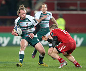 Sam Harrison of Leicester takes on Andrew Conway during the European Rugby Champions Cup match between Munster and Leicester Tigers at Thomond Park...