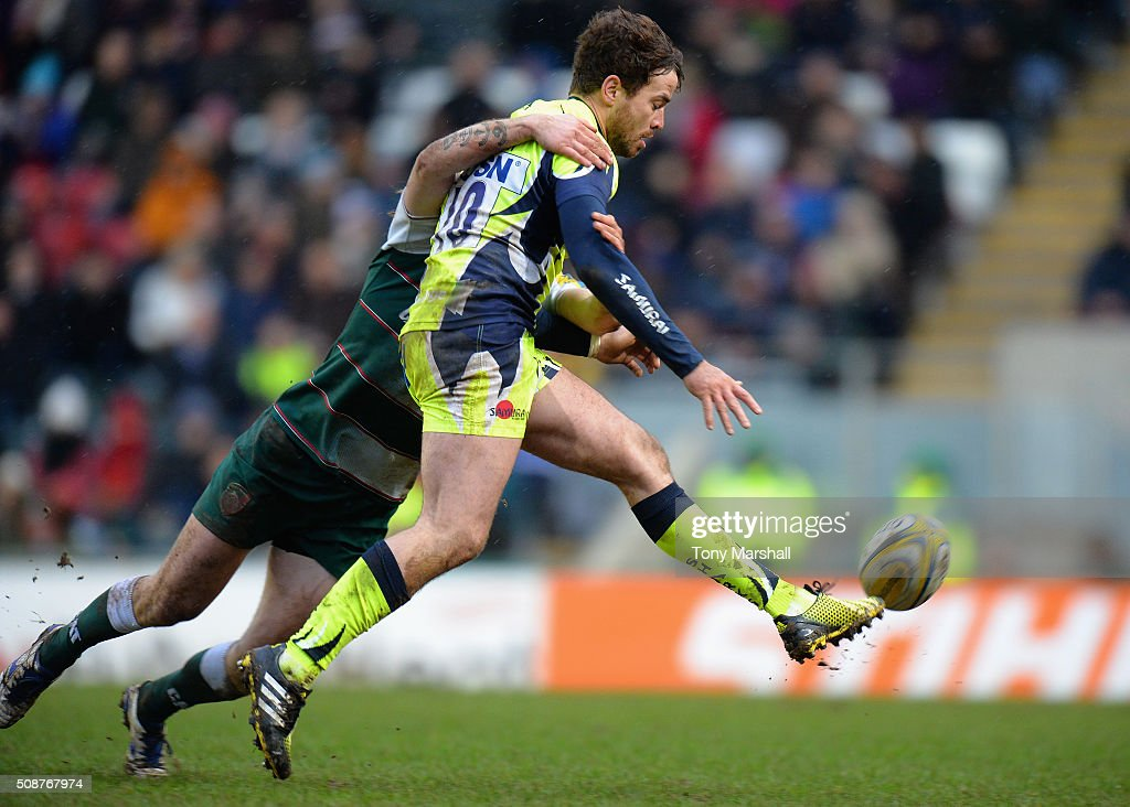 Sam Harrison of Leicester Tigers tackles <a gi-track='captionPersonalityLinkClicked' href=/galleries/search?phrase=Danny+Cipriani&family=editorial&specificpeople=688774 ng-click='$event.stopPropagation()'>Danny Cipriani</a> of Sale Sharks during the Aviva Premiership match between Leicester Tigers and Sale Sharks at Welford Road on February 6, 2016 in Leicester, England.