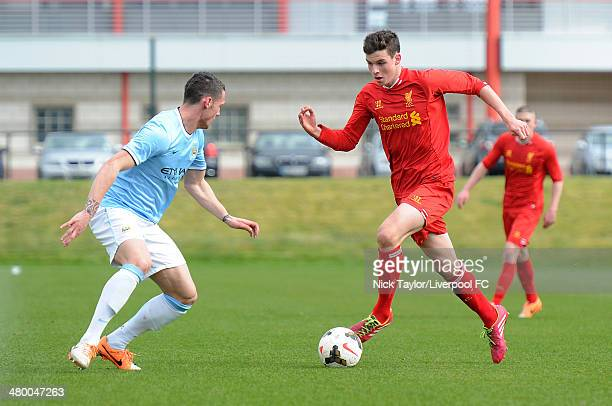 Sam Hart of Liverpool and Matheus Bossarts of Manchester City in action during the Barclays Premier League Under 18 fixture between Liverpool and...