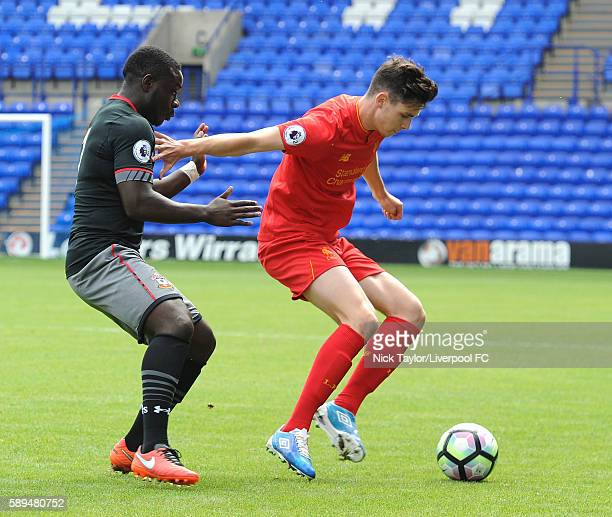 Sam Hart of Liverpool and Olufela Olomola of Southampton in action during the Liverpool v Southampton U23 game at Prenton Park on August 14 2016 in...