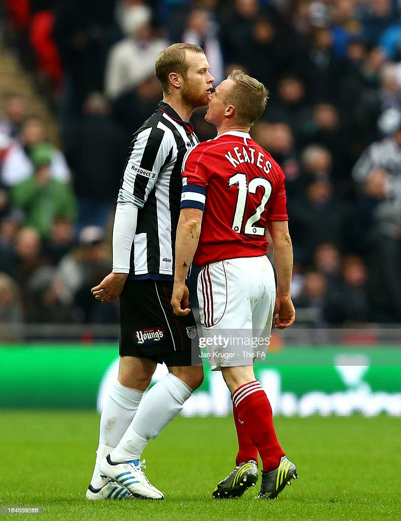 Sam Hatton of Grimsby Town and Dean Keates of Wrexham square up during the FA Trophy Final between Wrexham and Grimsby Town at Wembley Stadium on March 24, 2013 in London, England.