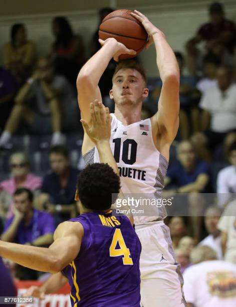 Sam Hauser of the Marquette Golden Eagles shoots over Skylar Mays of the LSU Tigers during the first half of their game at the Maui Invitational at...