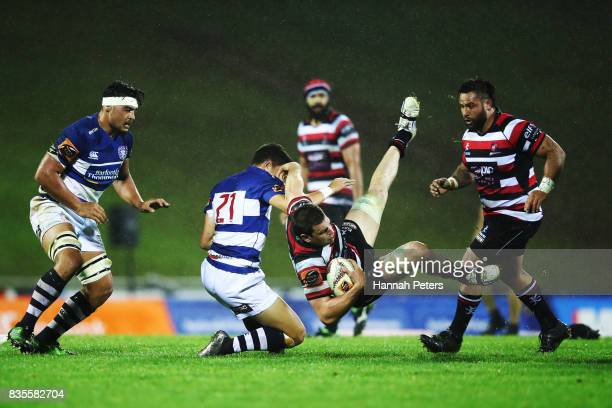 Sam Henwood of Counties Manukau is brought down during the round one Mitre 10 Cup match between Counties Manukau and Auckland at ECOLight Stadium on...