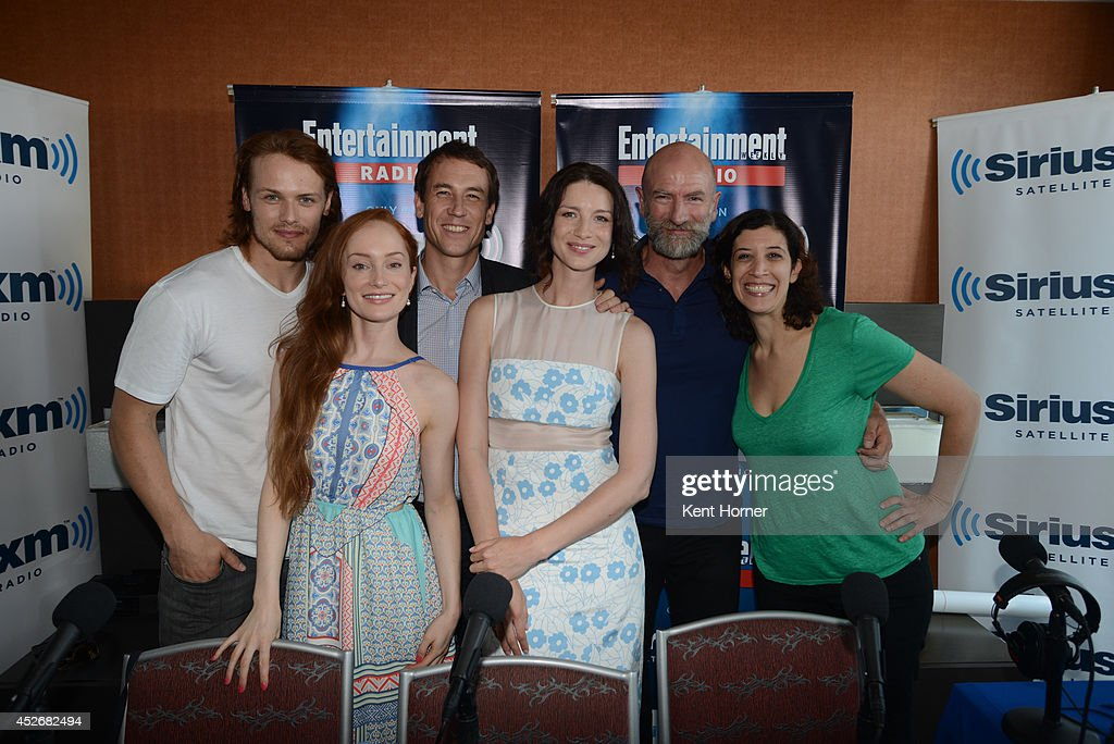 Sam Heughan, Lotte Verbeek, Ronald Moore, Caitriona Balfe and Graham McTavish pose with radio host Jessica Shaw after being interviewed on SiriusXM's Entertainment Weekly Radio channel from Comic-Con 2014 at The Hard Rock Hotel on July 25, 2014 in San Diego, California.