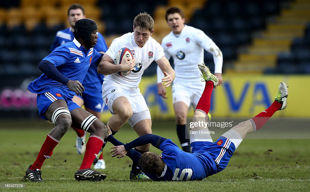 Sam Hill of England attempts to break free from the tackle of Yacouba Camara (L) and Maxime Wilprecht (R) of France during the U20s RBS Six Nations match between England U20 and France U20 at the Sixways Stadium on February 23, 2013 in Worcester, England.