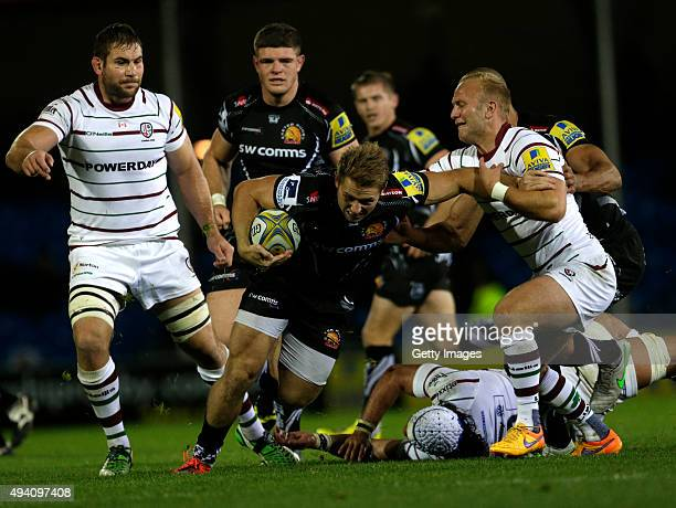 Sam Hill of Exeter Chiefs attempts to beat the defence of London Irish during the Aviva Premiership Match at Sandy Park on October 24 2015 in Exeter...