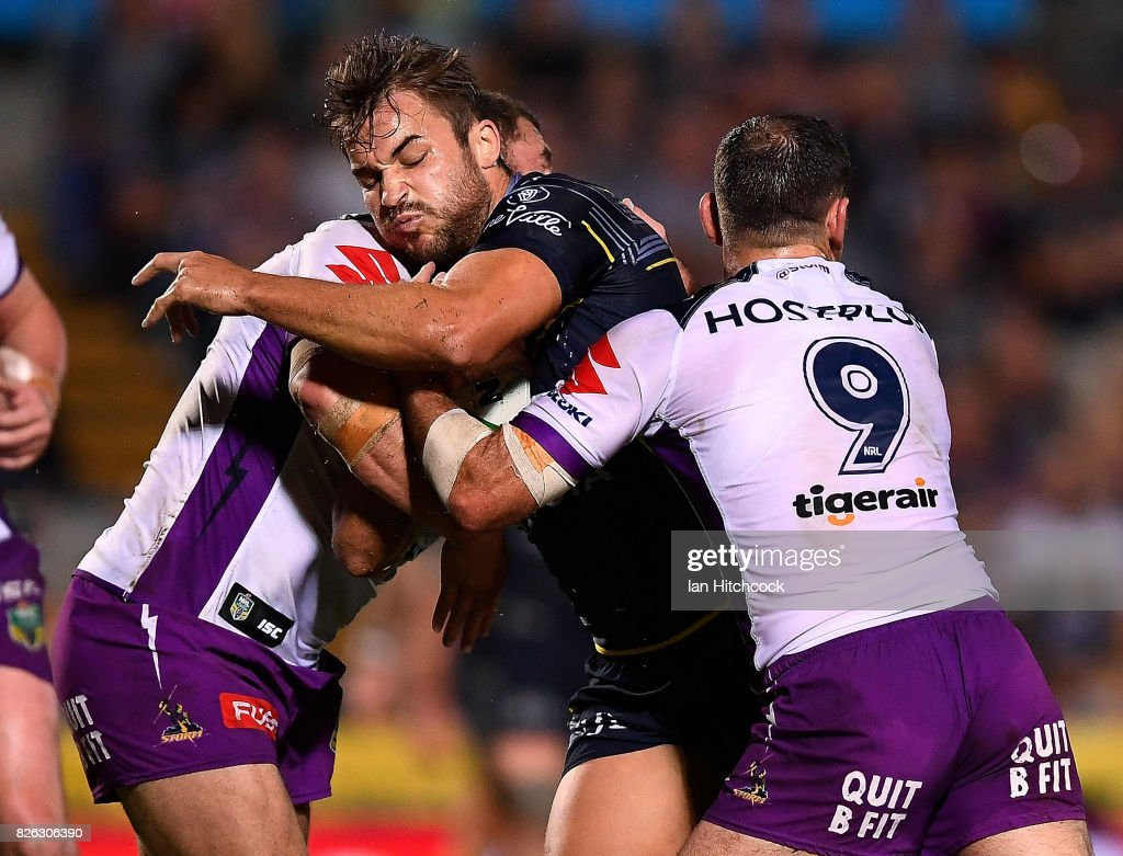 Sam Hoare of the Cowboys is tackled by Cameron Smith of the Storm during the round 22 NRL match between the North Queensland Cowboys and the Melbourne Storm at 1300SMILES Stadium on August 4, 2017 in Townsville, Australia.