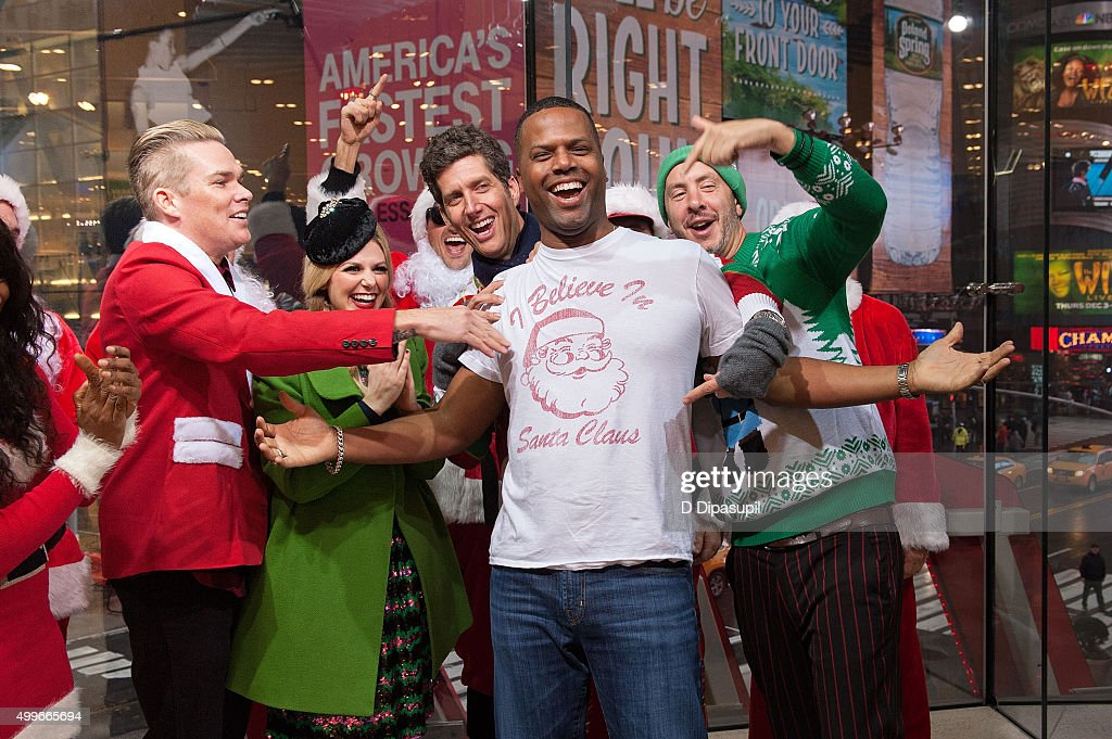 Sam Hollander AJ Calloway Kevin Griffin and Mark McGrath pose for a photo on the set of 'Extra' at their New York studios at HM in Times Square on...