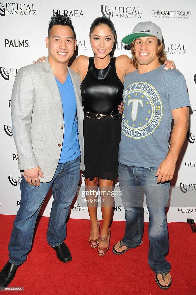 Sam Hon, <a gi-track='captionPersonalityLinkClicked' href=/galleries/search?phrase=Arianny+Celeste&family=editorial&specificpeople=4900711 ng-click='$event.stopPropagation()'>Arianny Celeste</a> and <a gi-track='captionPersonalityLinkClicked' href=/galleries/search?phrase=Urijah+Faber&family=editorial&specificpeople=2312319 ng-click='$event.stopPropagation()'>Urijah Faber</a> attend the Optical Panacea Launch Party at HERAEA at the Palms Casino Resort on May 24, 2013 in Las Vegas, Nevada.