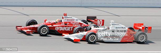 Sam Hornish Jr and Dan Wheldon race side by side on the 198th lap of the Kansas Lottery Indy 300 at Kansas Speedway in Kansas City Missouri Sunday...