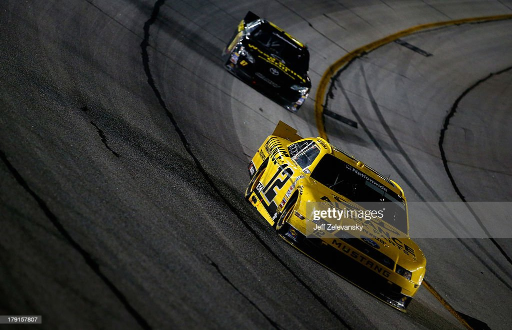 Sam Hornish Jr., driver of the #12 Alliance Truck Parts Ford, leads Joe Nemechek, driver of the #87 pelletgrillsusa.com Toyota, during the NASCAR Nationwide Series Great Clips/Grit Chips 300 at Atlanta Motor Speedway on August 31, 2013 in Hampton, Georgia.
