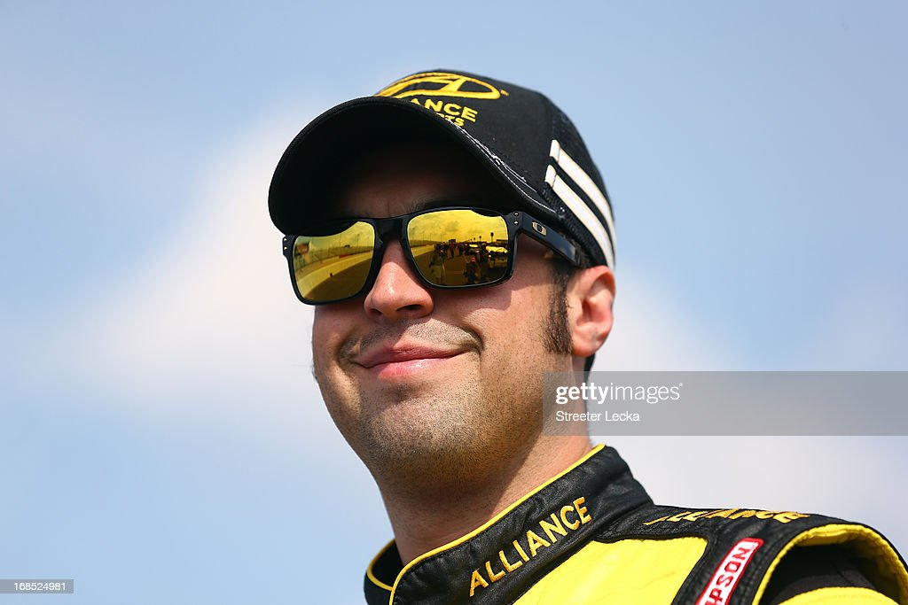 Sam Hornish Jr., driver of the #12 Alliance Truck Parts Ford, looks on during qualifying for the NASCAR Nationwide Series VFW Sport Clips Hero 200 at Darlington Raceway on May 10, 2013 in Darlington, South Carolina.