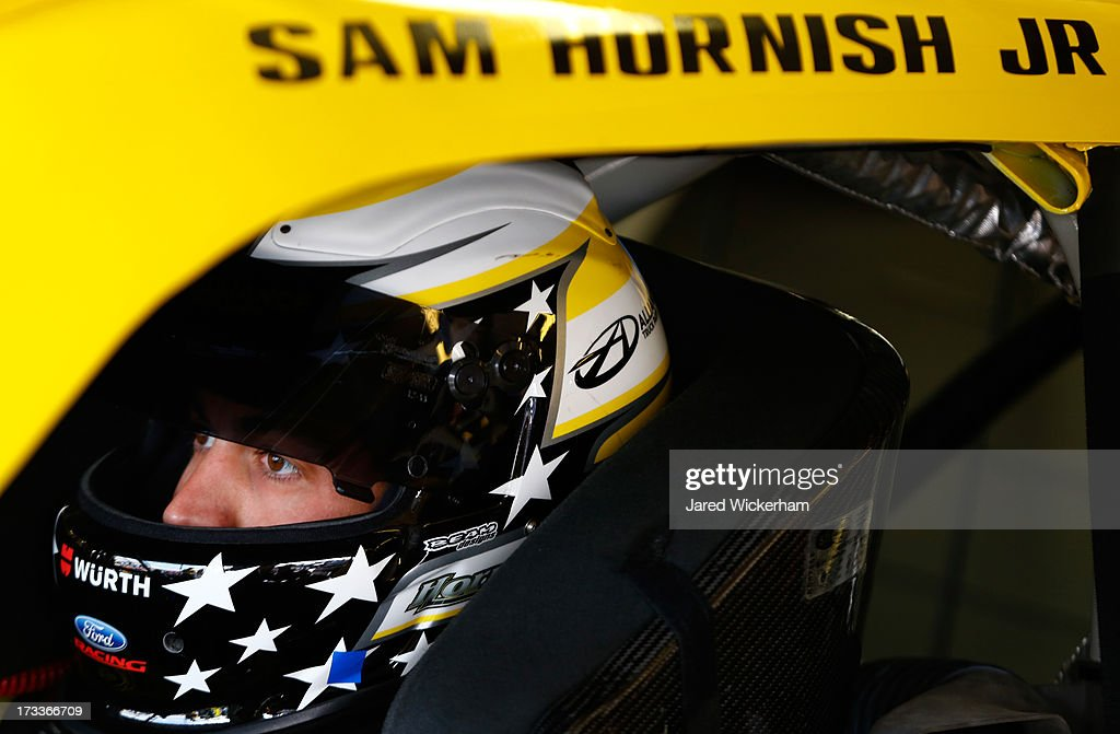 <a gi-track='captionPersonalityLinkClicked' href=/galleries/search?phrase=Sam+Hornish+Jr.&family=editorial&specificpeople=176571 ng-click='$event.stopPropagation()'>Sam Hornish Jr.</a>, driver of the #12 Alliance Truck Parts Ford, sits in his car during practice for the NASCAR Nationwide Series CNBC Prime's 'The Profit' 200 at New Hampshire Motor Speedway on July 12, 2013 in Loudon, New Hampshire.