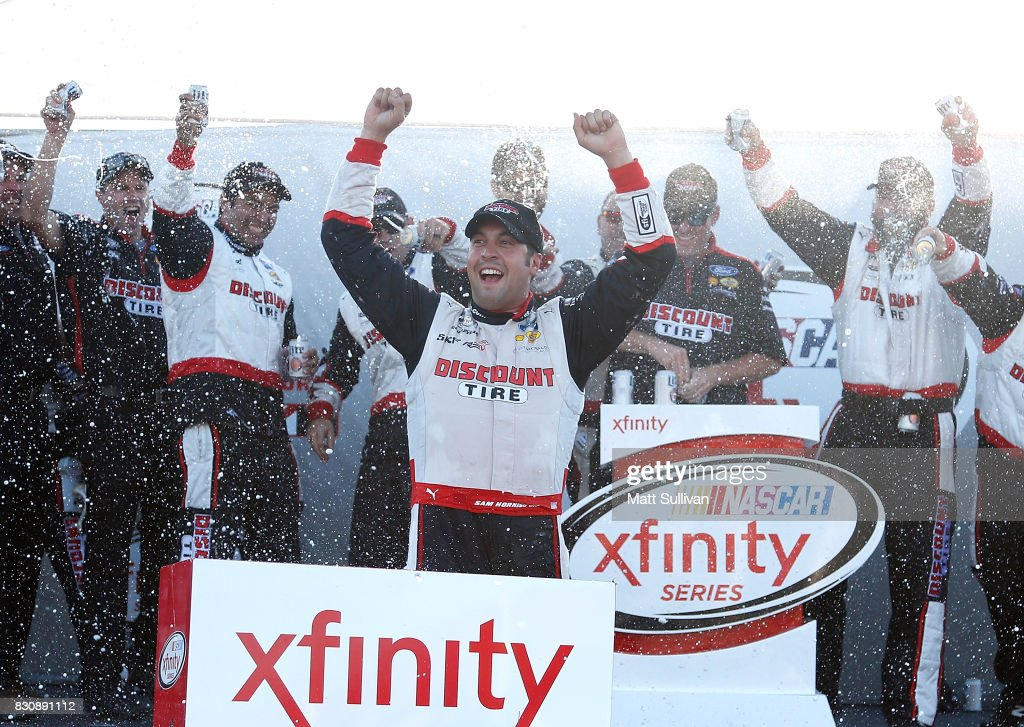 Sam Hornish Jr., driver of the #22 Discount Tire Ford, celebrates in victory lane after winning the NASCAR XFINITY Series Mid-Ohio Challenge at Mid-Ohio Sports Car Course on August 12, 2017 in Lexington, Ohio.