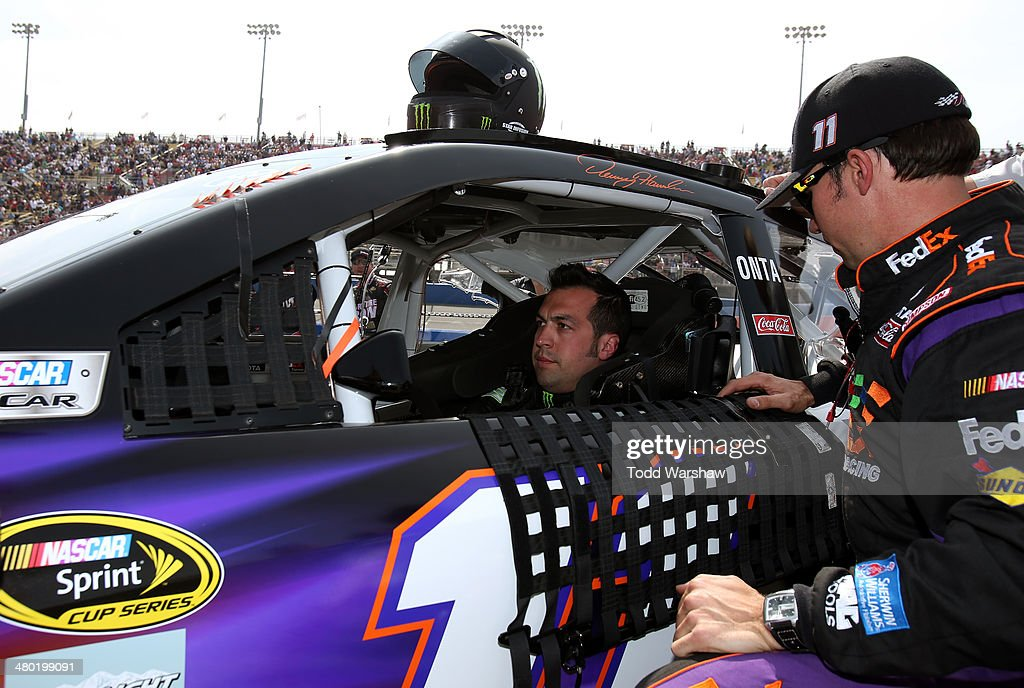 Sam Hornish Jr driver of the FedEx Express Toyota prepares for the NASCAR Sprint Cup Series Auto Club 400 at Auto Club Speedway on March 23 2014 in...